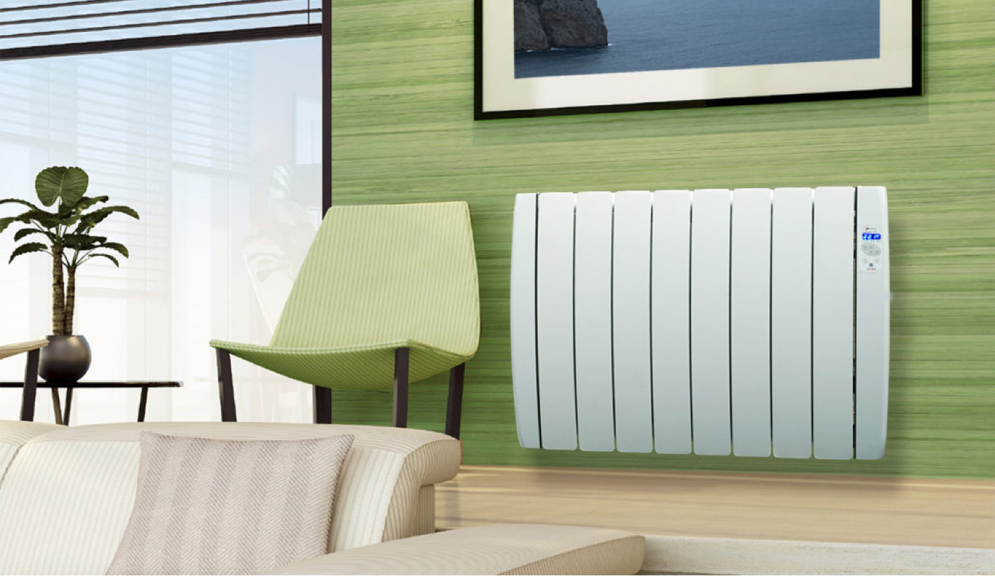 The Haverland RCTT Inerzia electric radiator on a green wall in a right colourful modern living space
